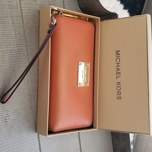 Michael Kors Orange wallet on a strap